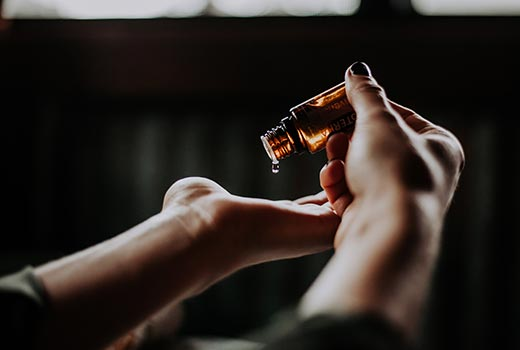 Use natural products for best skin care - Natural Oil in Hands - 520px